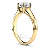 Four prong basket setting solitaire engagement ring yellow gold