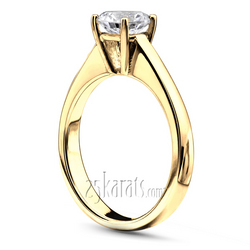 Yellow gold basket setting solitaire engagement ring