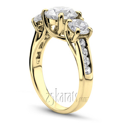 Yellow gold three stone trellis ring