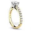 Yellow gold engagement ring micro pave setting