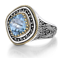 Sterling silver and 18k yellow blue topaz ring