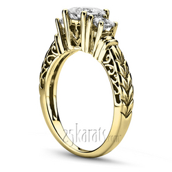 Princes cut three stone yellow gold engagement ring