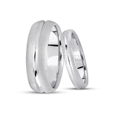 His and her simple carved wedding bands