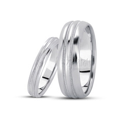 His and her basic carved simple wedding bands