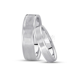 His and her basic carved wedding bands